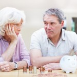 Portrait of senior couple unhappy about their savings at home